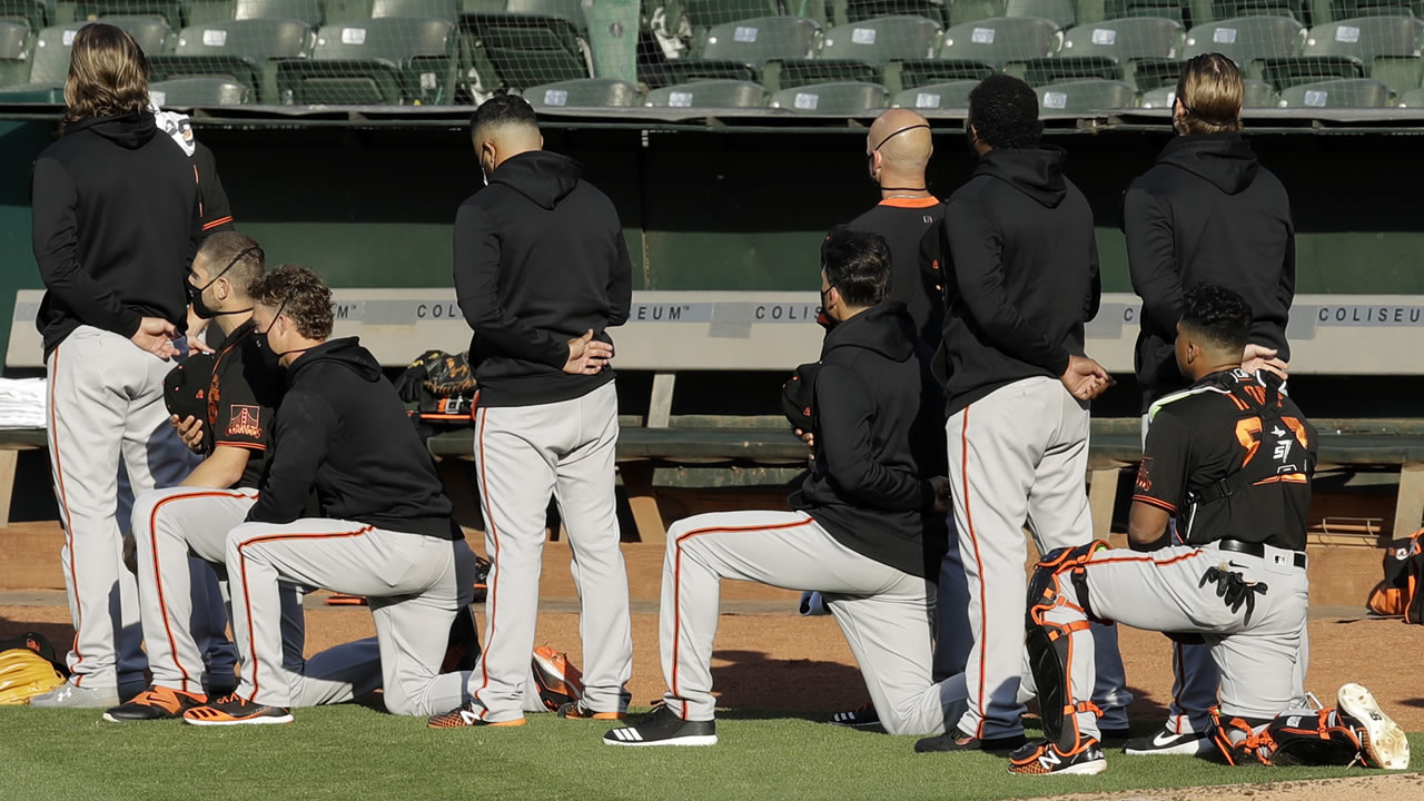 San Francisco Giants Manager Gabe Kapler and several players and staff took a knee